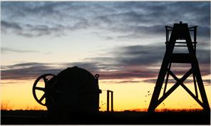 Oil Pump Silouhetted Against the Sunset