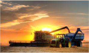 Combine Silouhetted by the Sunset