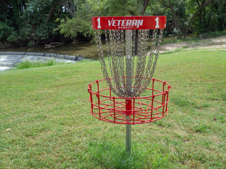 Frontier East red disc golf goal